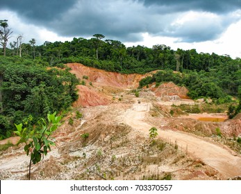 Rainforest destruction. Abandoned gold mining pit in Guyana, South America.