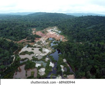 Rainforest destruction. Aerial photo of gold mining place in Guyana, South America. Amazon and Essequibo basin deforestation. Brazil deforestation. Venezuela deforestation.
