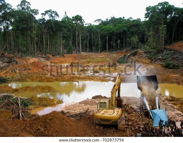 Rainforest destruction. Gold mining place in Guyana, South America. Similar as in Brazil. Amazon and Essequibo basin deforestation, mercury contamination. Venezuela, Suriname, French Guyana -the same.
