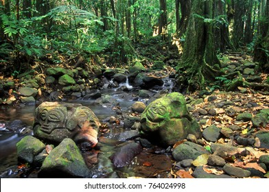 Rainforest stone carvings on tropical Moorea French Polynesia