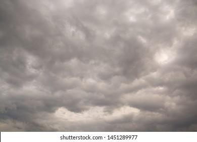 Raining cloud on Dramatic grey Sky as Weather Idea