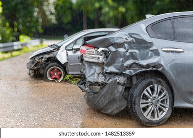 Raining day front of light gray color car crash with back side of  gray color car 2 car have damaged and broken by accident on road parking can not dirve any more.
