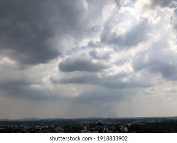 Raining sky over the city. Cloudy sky atmosphere. Natural weather moment in rainy day.