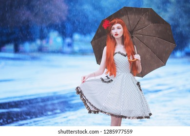 Raining weather. Autumn rain. Sad girl in sorrow in dress hold umbrella.  Umbrella protection against street. Lonely woman with disease was caught in rain. Sad girl in sorrow. Autumn disease