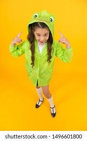 Rainproof accessories make rainy fall day pleasant. Waterproof accessory. Kid girl happy wear raincoat. Cute raincoat kids would love. Frog style. Schoolgirl hooded raincoat enjoy fall weather.