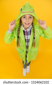 Rainproof accessory. Schoolgirl hooded raincoat enjoy rainy weather. Waterproof clothes every kid should try. Kid girl happy wear raincoat. Waterproof cloak. Waterproof fabric for your comfort.