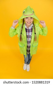 Rainproof accessory. Waterproof clothes every kid should try. Kid girl happy wear raincoat. Waterproof cloak. Waterproof fabric for your comfort. Schoolgirl hooded raincoat enjoy rainy weather.