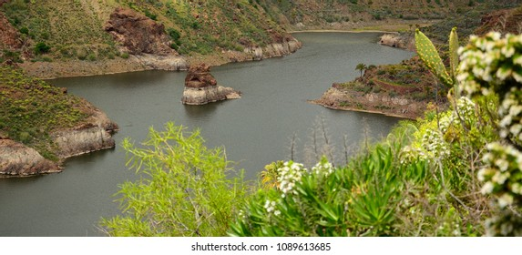 Rainwater dam with interior island, La sorrueda, Canary islands