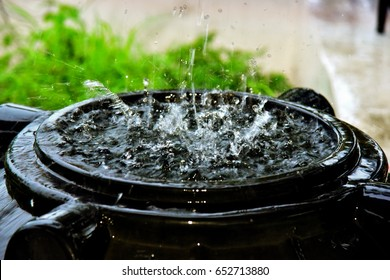 Rainwater harvesting during monsoon rains, top down composition. Water day.