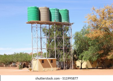 Rainwater harvesting in storage tanks, public drinking water distribution in Namibia, southern Africa. Water scarcity and shortage, symbol of extreme drought African areas