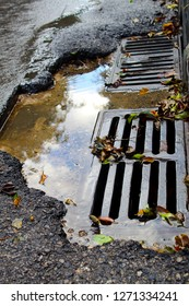 Rainwater runoff in an Israeli city. Sewer drain on the road in Israel