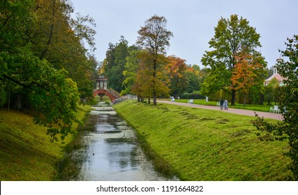 A rainy autumn day in the Alexander Park in Pushkin, or Tsarskoye Selo, Saint Petersburg, Russia, with the small canal and the Chinese-style Krestovy Bridge (Cross Bridge)