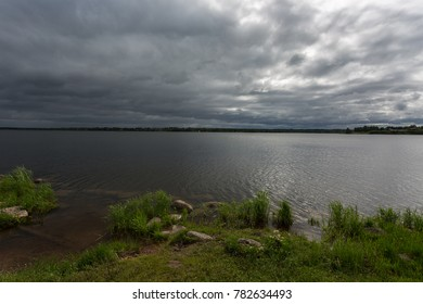 Rainy dark clouds over the lake. Summer landscape. Russia.