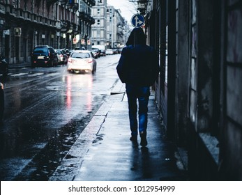 Rainy day with man alone in the city
