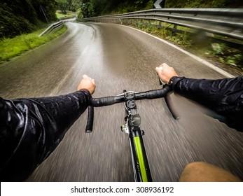 rainy day,man on road bike. POV, Original Point of View.