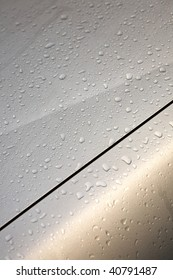 The rainy drop which flows to a hood of a car.