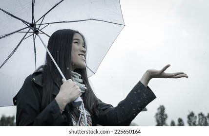 rainy. girl checking rain drops with her hand. concept about autumn and bad weather