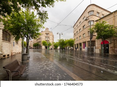 Rainy Jerusalem: Jaffa street, generali building, bench