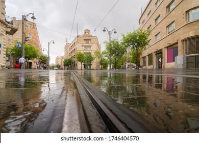 Rainy Jerusalem: Jaffa street, tram railway, generali building