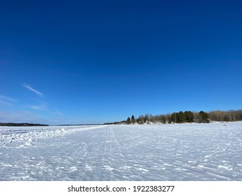 Rainy Lake Ice Road on a bright, sunny day