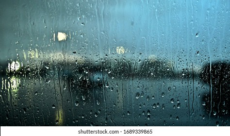 Rainy morning through wet window