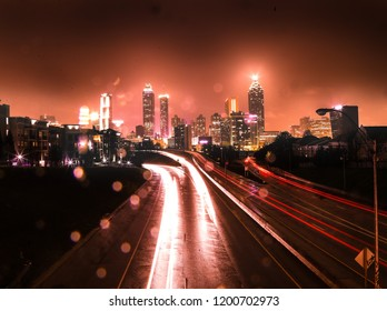 Rainy night in atlanta with red city and highway lights, taken from Jackson Street Bridge