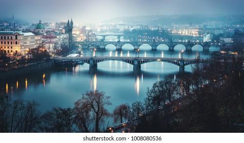 rainy night view of charles bridge at prague in czech winter. charles bridge in praha