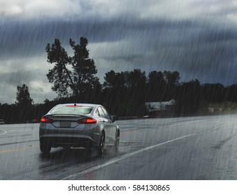 Rainy road with car