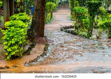 Rainy season in Uganda. The rain is so destructive that it breaks everything. The small road here is flooded after a rain shower.