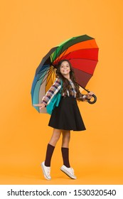 Rainy september. Towards knowledge. Schoolgirl with backpack. Schoolgirl daily life. Girl with umbrella. Rainy day. Happy childhood. Kid happy schoolgirl with umbrella. Fall weather forecast.