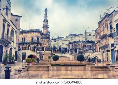 rainy spring day of Ostuni square with Saint Orontius' column, Italy