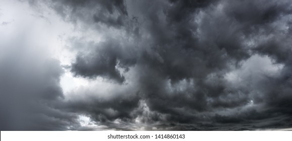Rainy and stormy in dark clouds shadow make sky in black. The rain is coming soon. Pattern of the clouds can not predict this is Tornado, Hurricane or thunderstorm. Sometimes heavy clouds but no rain