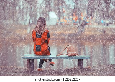 rainy weather girl posing fall / raindrops, spray, girl adult on a rain background