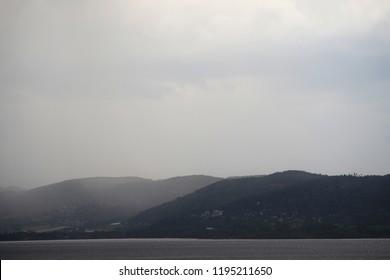 Rainy weather over drammen fjord, dramatic landscape.