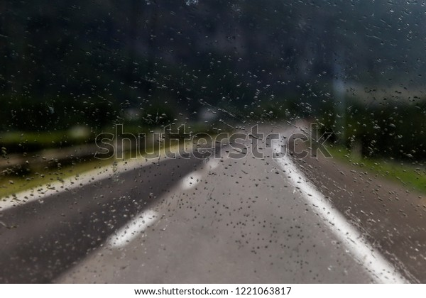 Rainy window during a drive, roadtrip with rain, thunderstorm, rain background