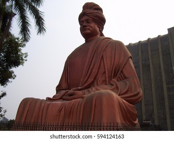 Raipur, Chhattisgarh, India - Jan 7, 2009 Huge, red, copper color statue of Swami Vivekananda at Burha Talab