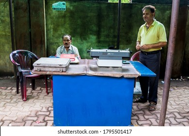 Raipur, Chhattisgarh, India/ October 25, 2019: A typist using vintage typewriter for typing legal document.