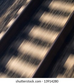 Rairoad Train Train Tracks Motion Blur captures the conceptual qualities of speed, or motion with a blur.