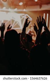 Raise your hand to worship God.