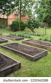 Raised beds before planting in a vegetable garden within a formal English garden
