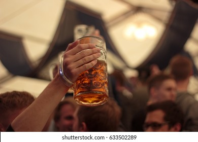 Raised beer stein Concept: Oktoberfest, Party, Celebration, Bavaria