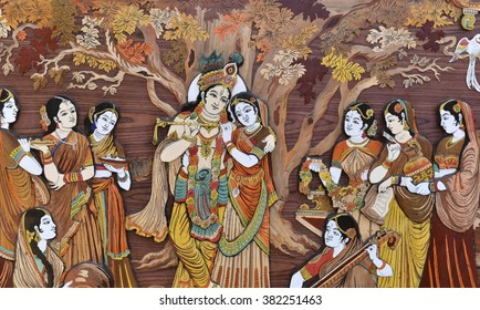 Raised crafted Indian Hindu Gods Krishna and Radha on wood, whole background