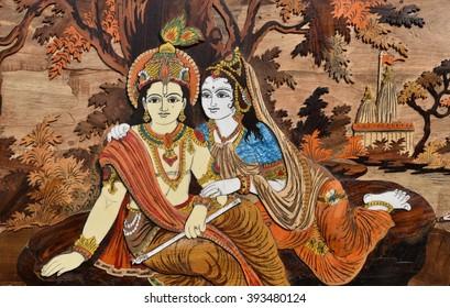 Raised crafted Indian Hindu Gods Krishna and Radha on wood, whole background