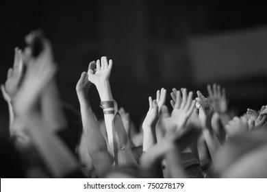 Raised up from the emotions of the hands at a musical concert