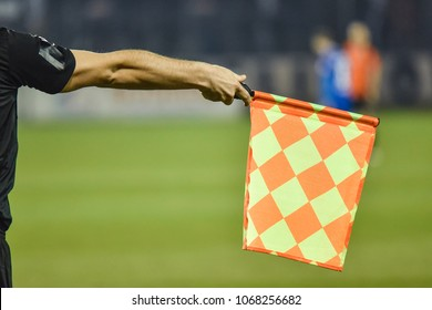 Raised flag of the assistant football referee