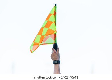 Raised flag by assistant of football referee