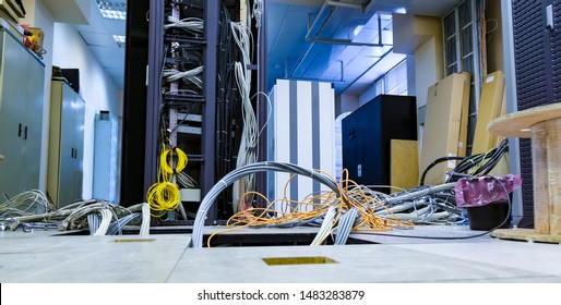 Raised floor and suction tool in modern interior of server room in datacenter