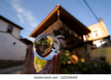 Raised granary is reflected over a glass ball