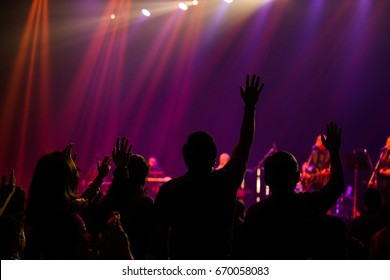 raised hand for worship concert