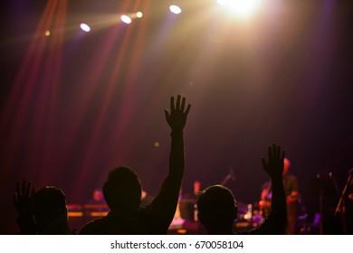 raised hand in worship concert